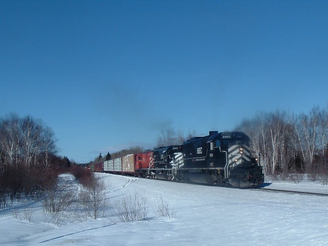 NBEC 6904 with train NBEC 402 in Belledune