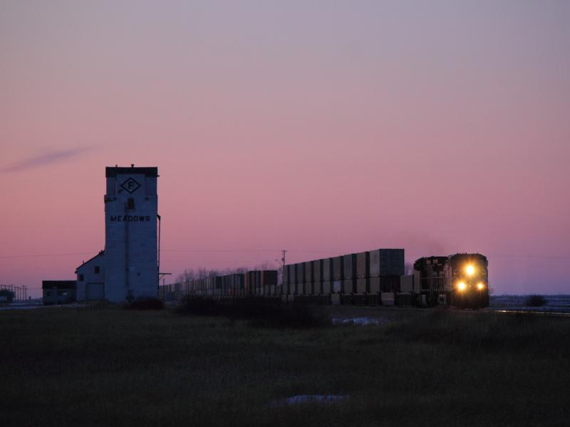 CEFX 1050 leads a train past the Meadows grain elevator