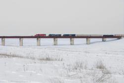 CP 6029, CSX 442 and CSX 861 cross the Floodway in Winnipeg 2014/03/09
