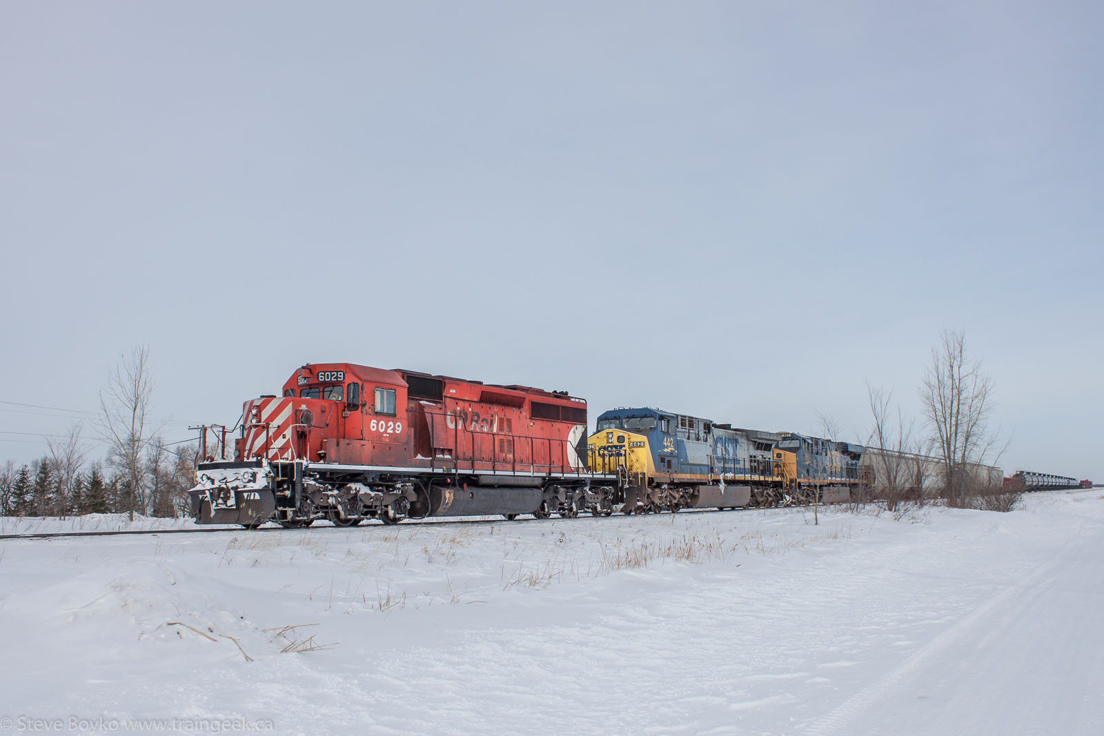 CP 6029 and CSX at Grande Pointe, MB 2014/03/09