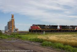 CN 2560 passing the new CWB elevator at Bloom, MB 2015/07/27