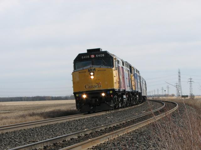 VIA 6408 and the Canadian rounding the bend