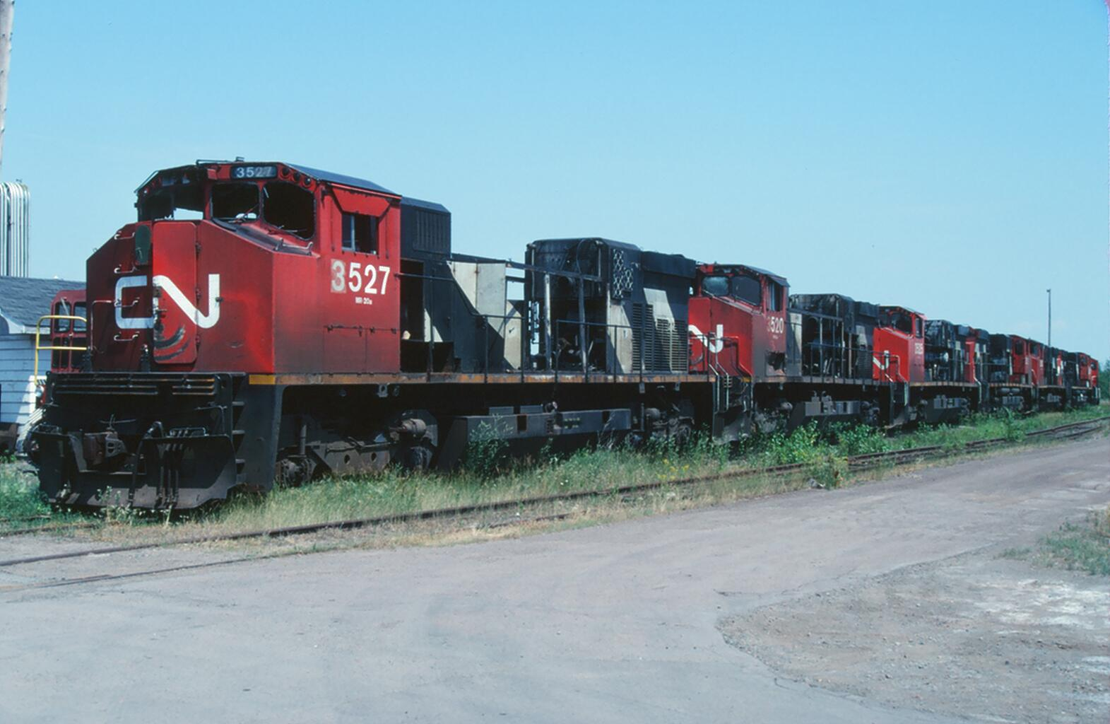 CN 3527, 3520, and 3525 in Moncton, NB 1997/08/12. Slide by WA Gleason.