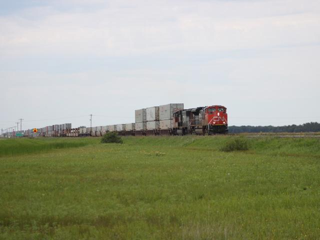 CN 8866 leads train 198 near Diamond, MB