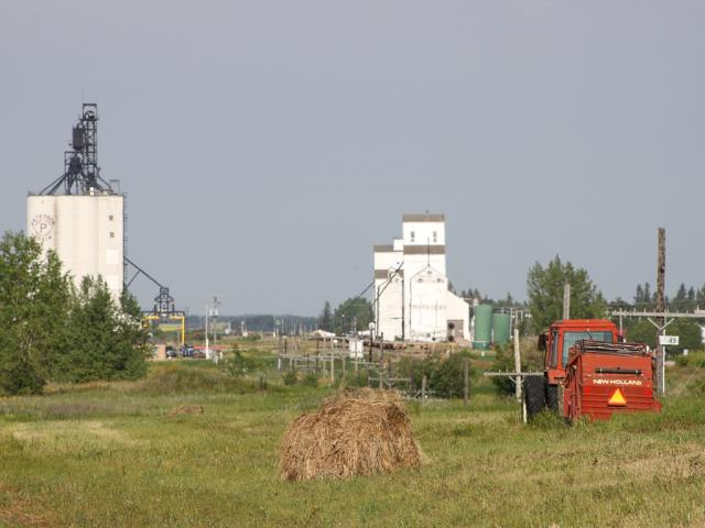 Indian Head grain elevators and tractor