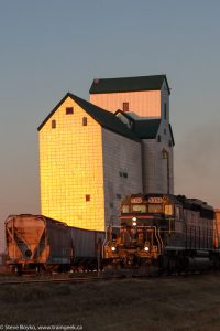 CEMR passing the Sanford, Manitoba grain elevator