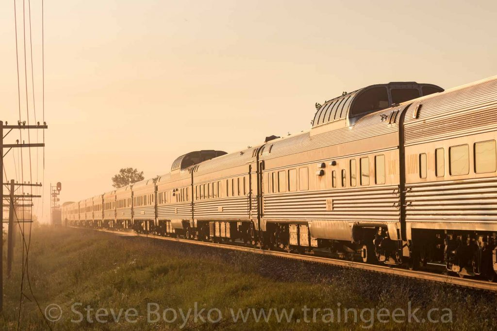 Stainless steel rail cars at sunrise
