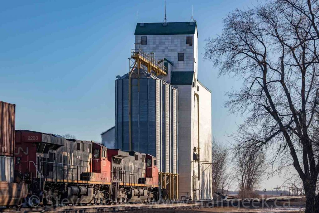 Train photos are better with grain elevators in them.