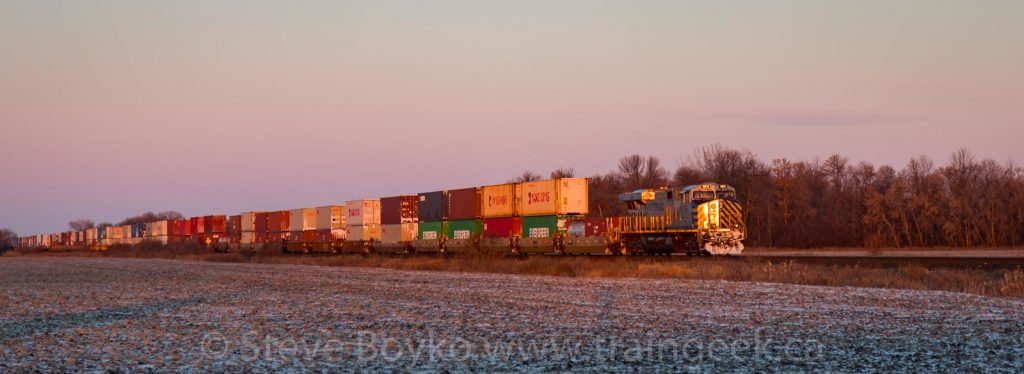 Container train at sunrise