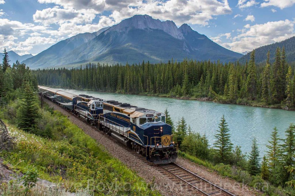 The Rocky Mountaineer heads west along the Bow River between Banff and Lake Louise, Alberta.