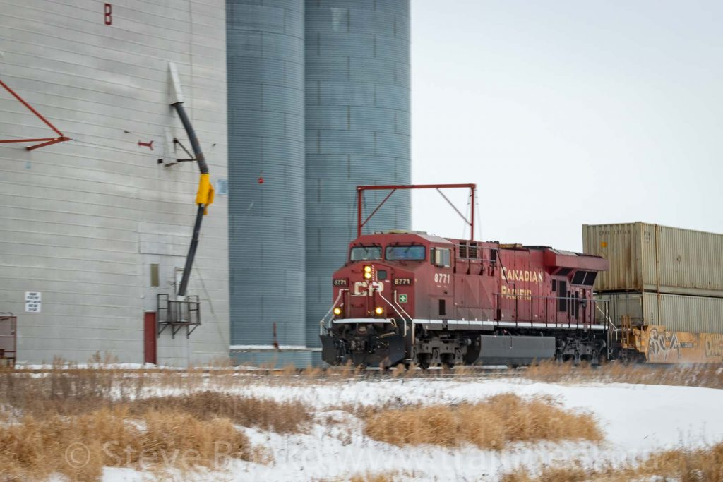 CP 8771 passing the Pense grain elevator
