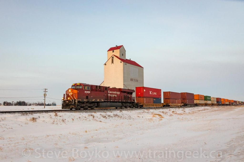 CP 9360 passing the Dog River, er, Rouleau grain elevator