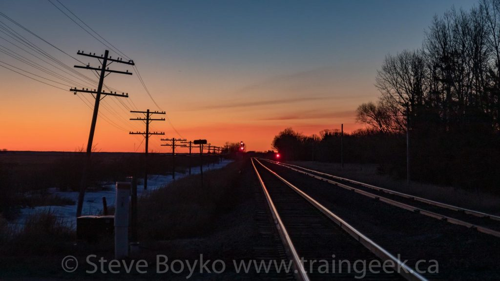 Sunrise, telegraph lines and rails