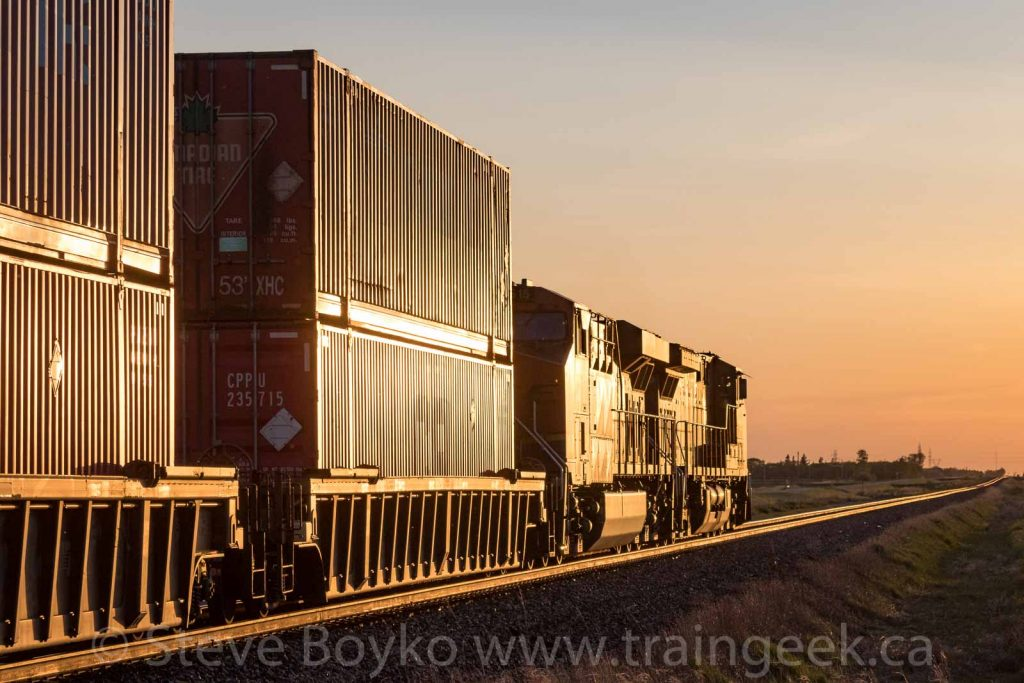 BNSF 6615 and CP 8100 going west into the sunset