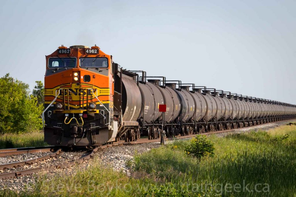 BNSF 4962 on the tail end of an oil train