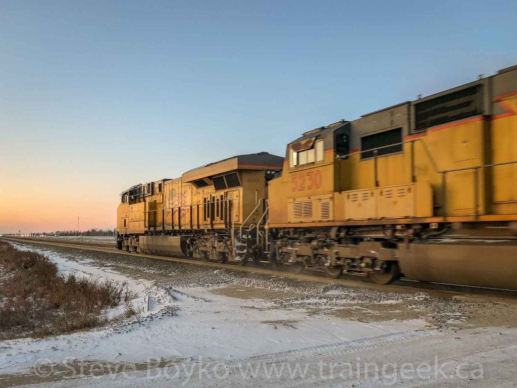 UP 5230 and 8065 heading into the sunset