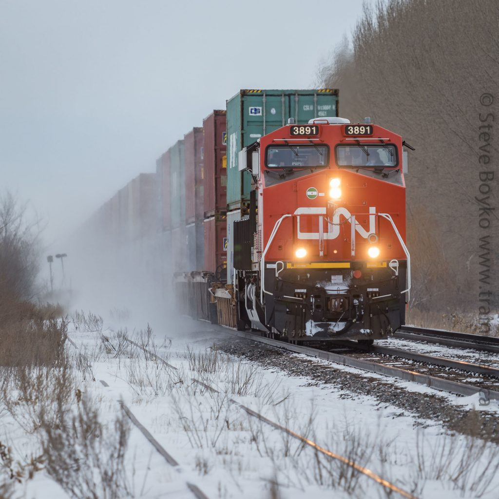 CN 3891 stirring up the snow