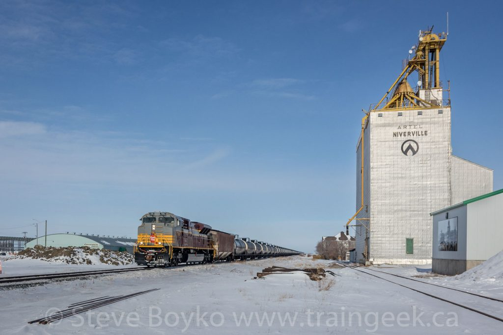 CP 7016 passing the Artel grain elevator in Niverville