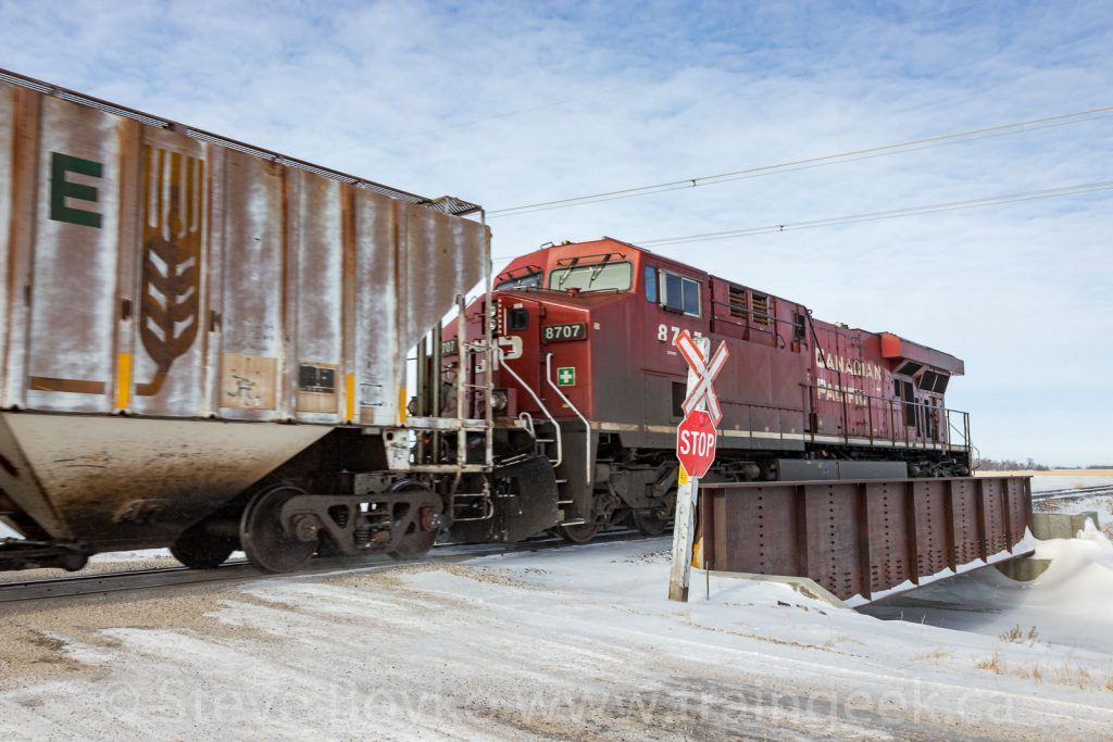 CP 8707 on the tail end of an oil train