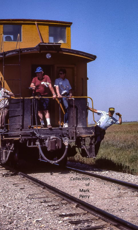 Convention members on the caboose