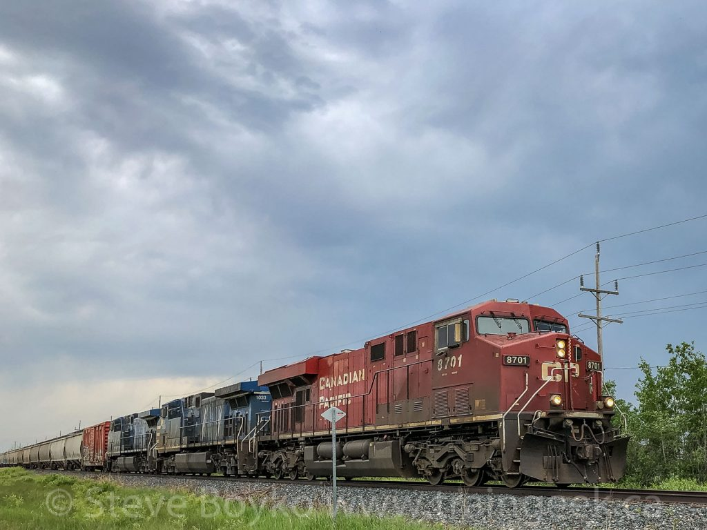 CP 8701 and leased locomotives on their way to the border