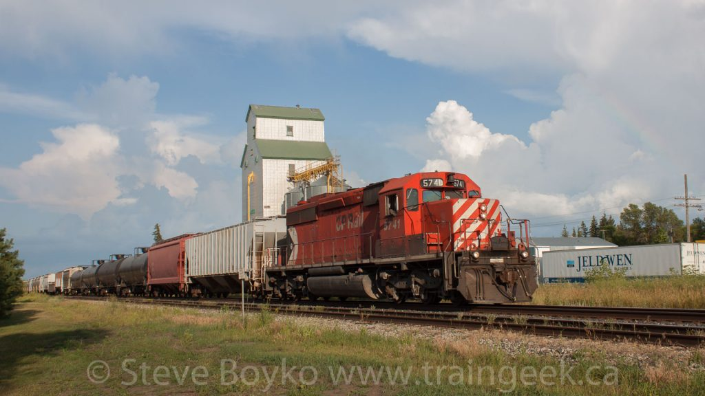 CP 5741 passing the Austin, Manitoba grain elevator