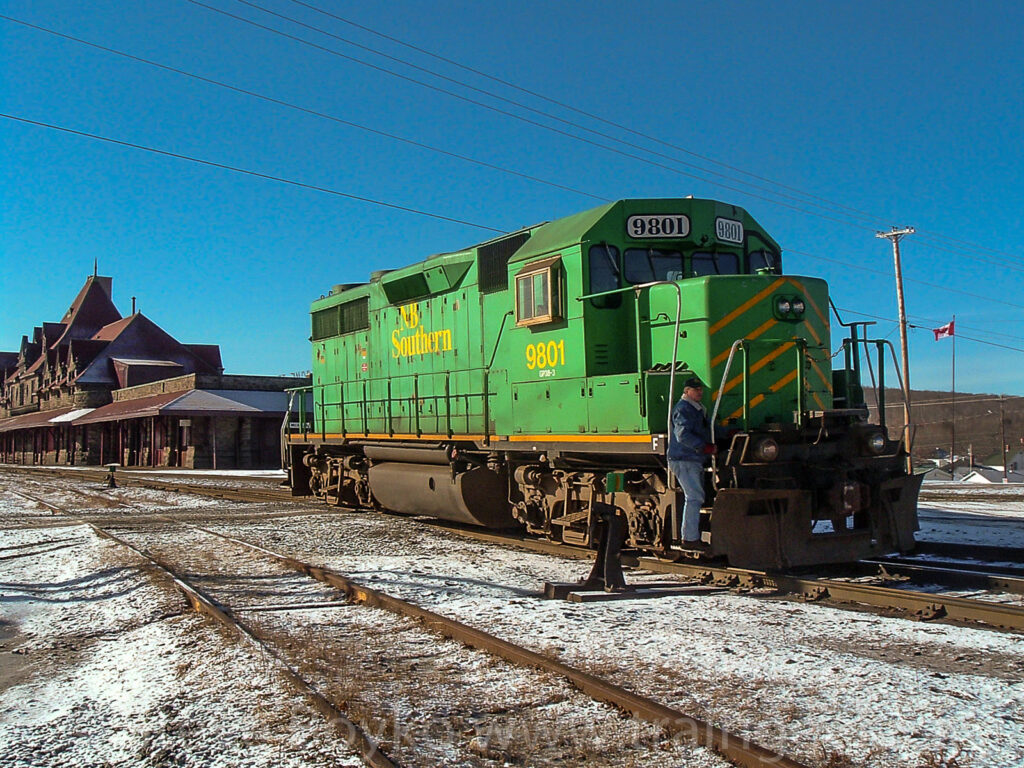 Engine 9801 rolls through McAdam, New Brunswick, January 2005