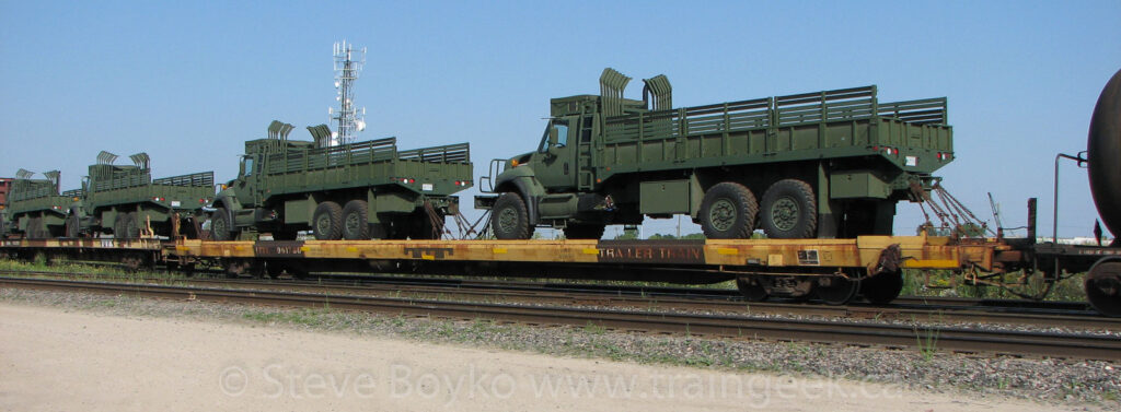 Military trucks on flatcars