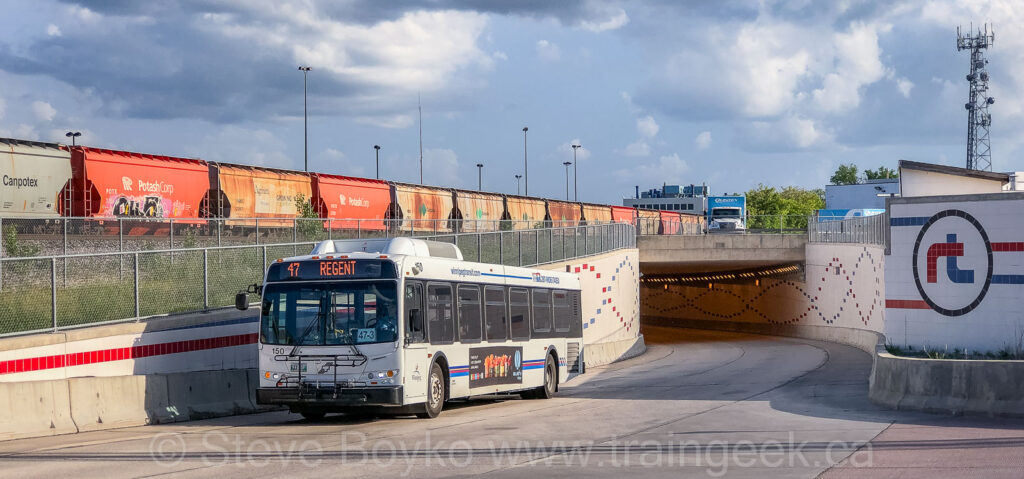 A bus emerging from the tunnel under the CN yard