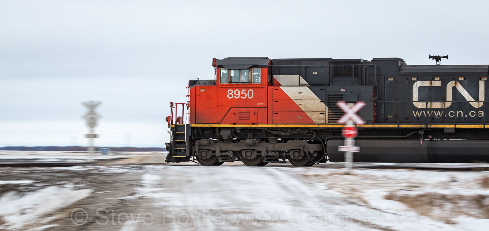 CN 8950 rolling through a crossing near Elie, MB