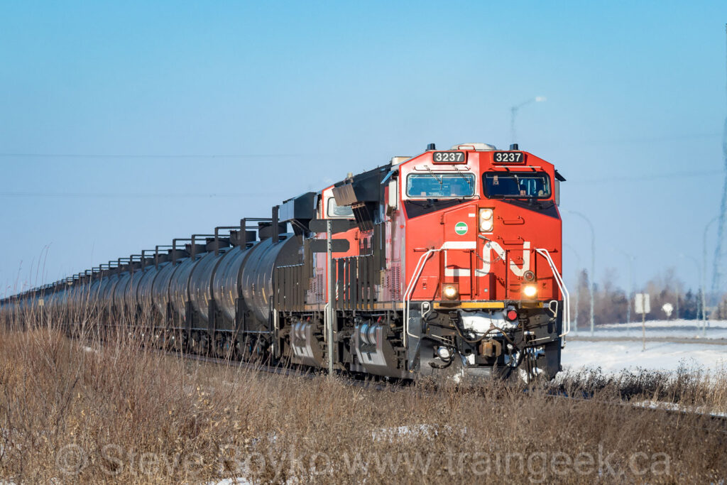 CN 3237 on the point of a tank train