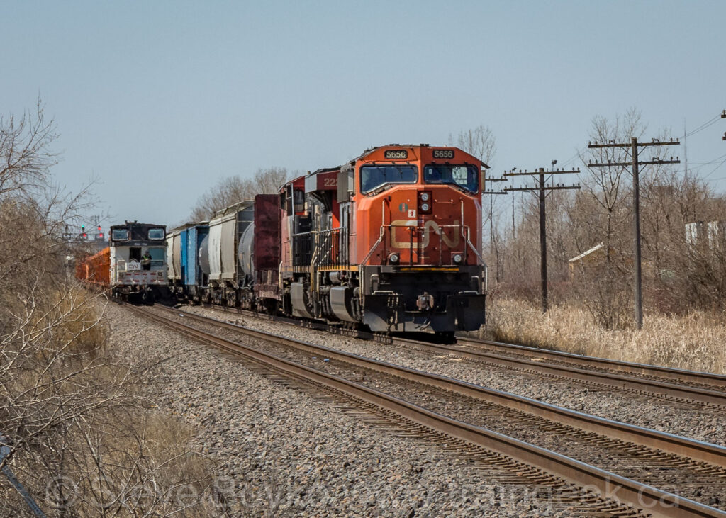 Caboose passing CN 5656 East