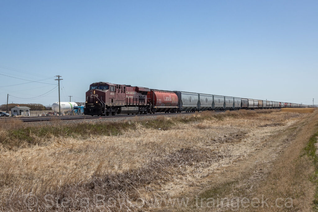 CP 8928 West with a lot of grain cars